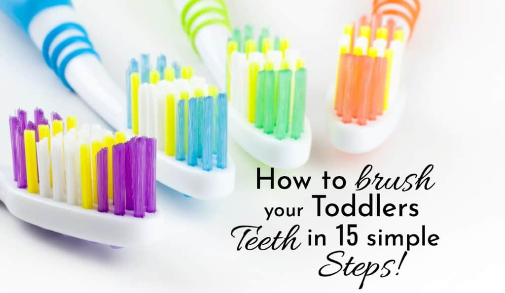 How to brush your toddlers teeth in 15 simple steps. Brightly colored toothbrushes.