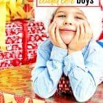 3 year old boy getting gifts for Christmas