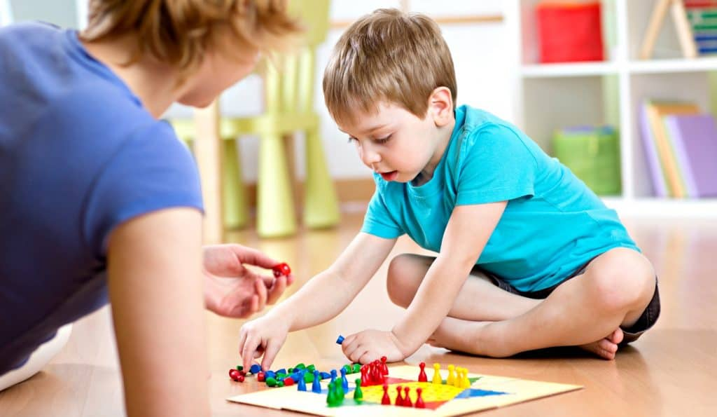 mom and little boy playing the best board games for toddlers