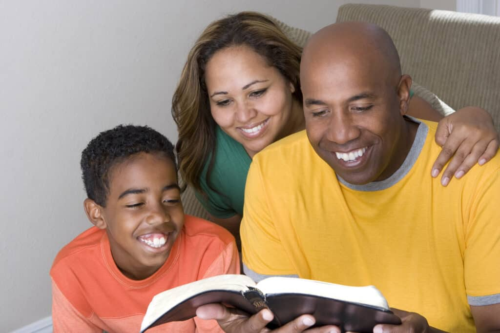 family reading bible together and discovering biblical parenting principles