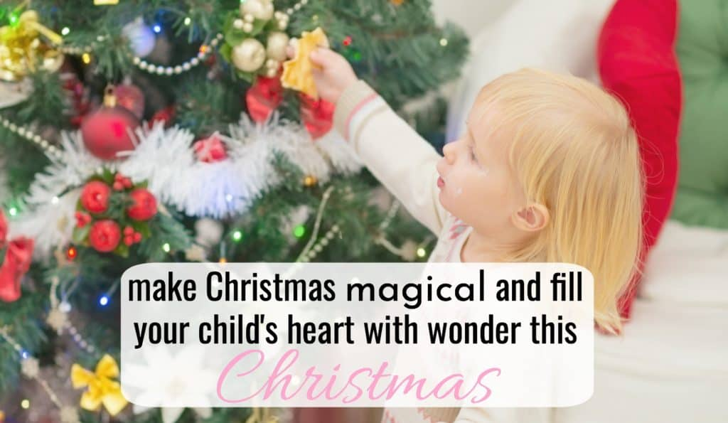 little girl filled with christmas wonder as she decorates a christmas tree while making christmas magical