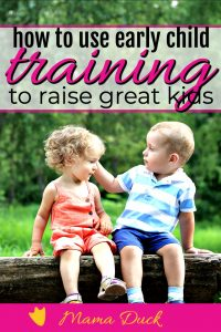 two small children sitting on a tree branch being kind as a result of child training tips