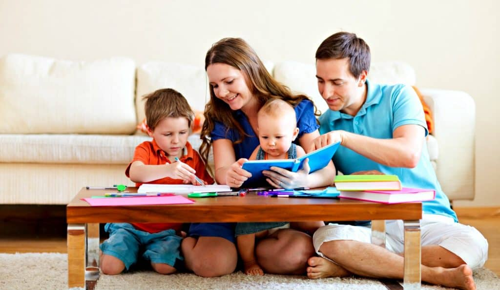 family having fun during family game night with toddlers