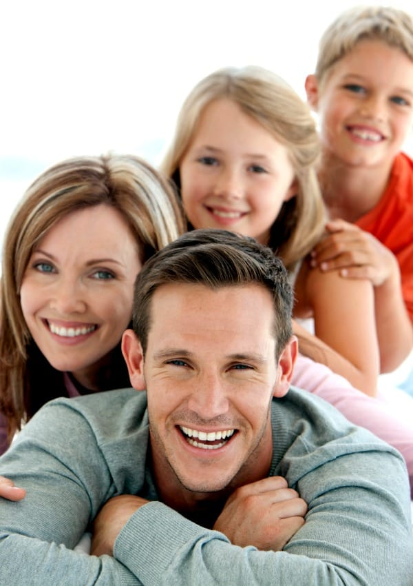 family smiling and happy after creating family meeting agenda