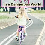 little girl riding bike by herself on the road free range parenting safely
