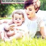 cute toddler girl and mom sitting on grass gentle parenting
