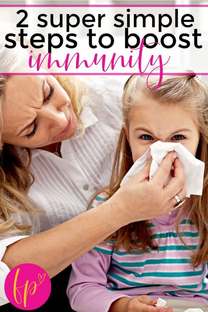 mom wiping child's nose trying to keep kids healthy during flu season