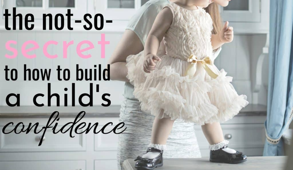 little girl standing on the counter as mom discovers how to build a child's confidence