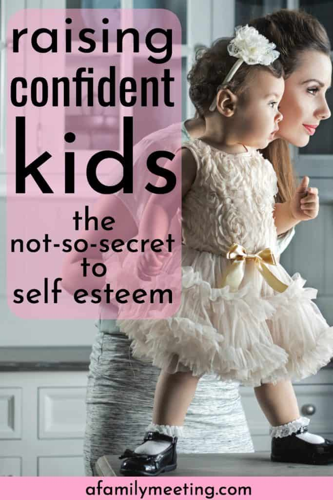 little girl standing on the counter building child confidence while her mom holds her