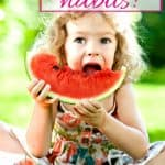 little girl with healthy eating habits for kids eating watermelon in summer