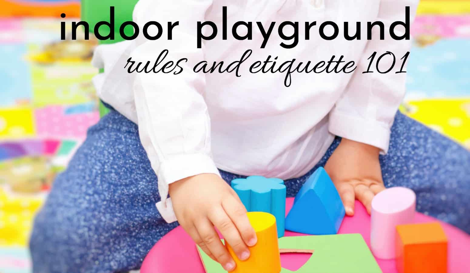 little girl following indoor play area rules and etiquette while playing with colorful blocks on the floor