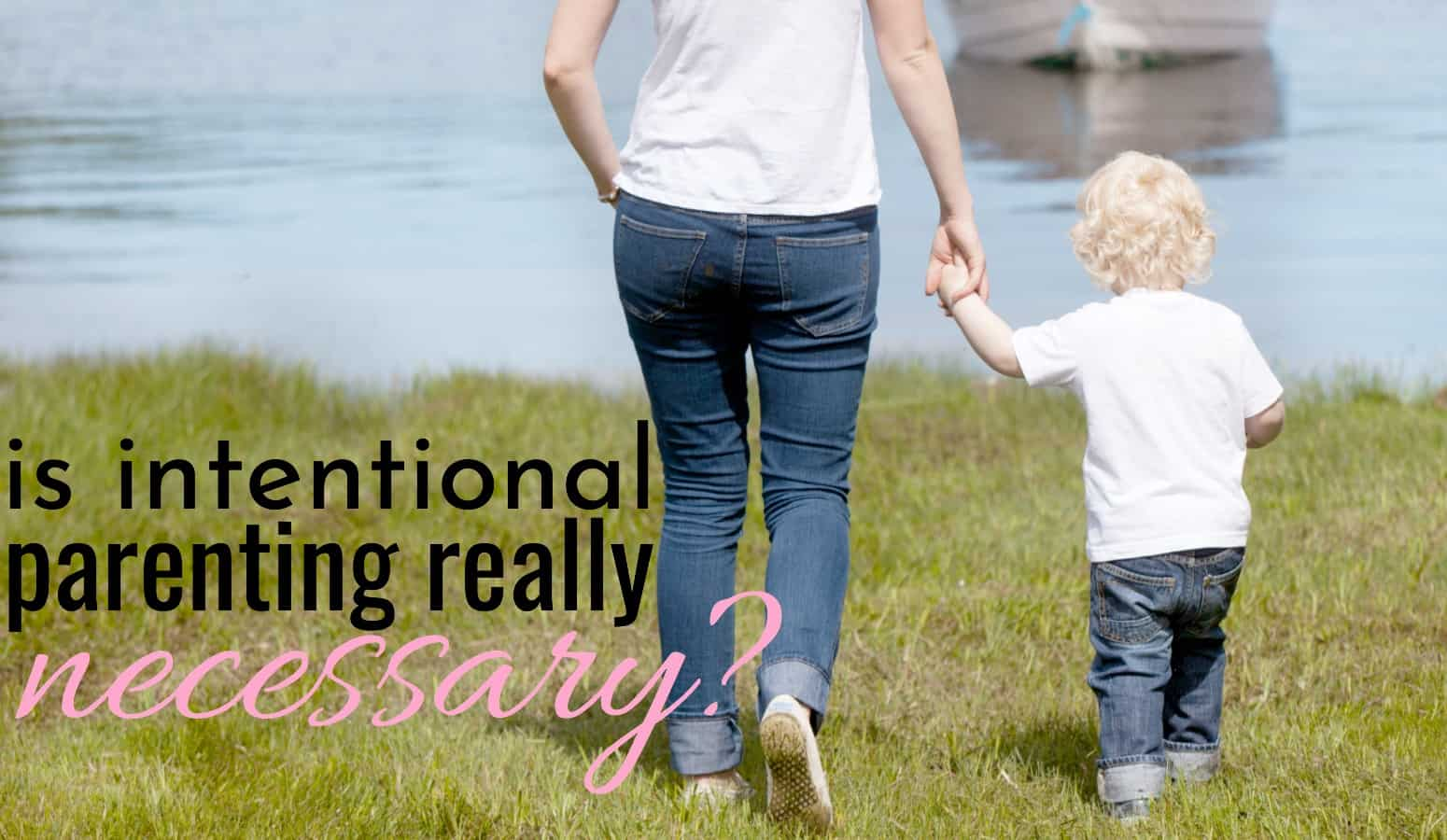 mom intentionally parenting her son as they walk hand in hand by a lake