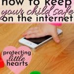 little baby hand playing with iphone with dangerous internet for kids, on the floor with colorful blocks parents need internet safety tools for kids