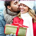 handsome man giving pretty wife Christmas gift from the useful gifts for mom gift guide