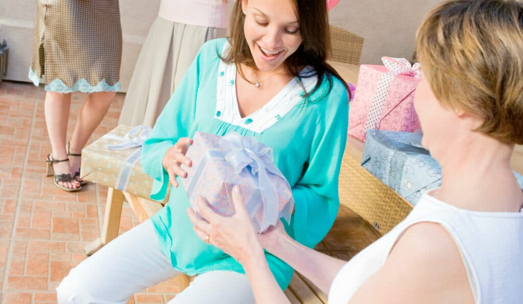 new mom getting new mom gift at baby shower