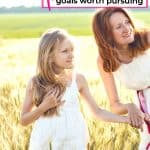 mom and daughter in wheat field pursuing parenting goals