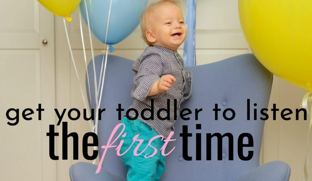 toddler not having first time obedience while standing on blue chair with ballon