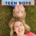 mom and son laughing and playing on the grass about the truth about parenting teen boys
