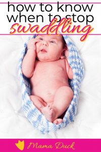 baby boy in blue swaddle mom is wondering when to stop swaddling baby