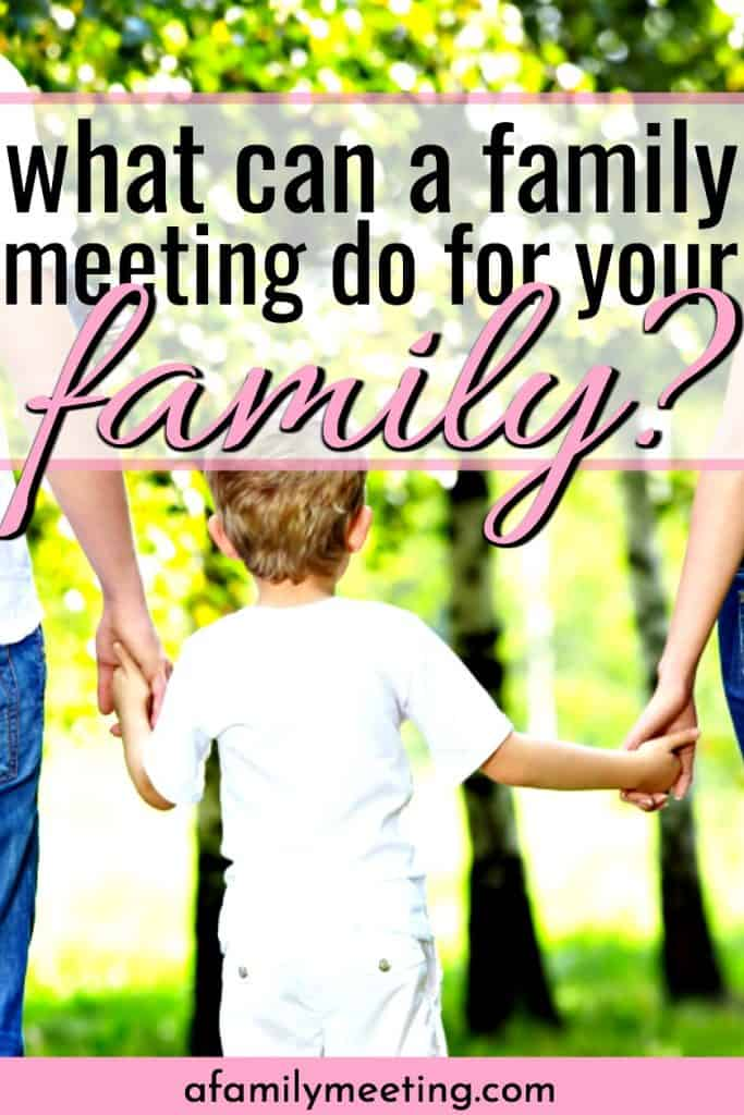 family walking hand in hand holding a family meeting while walking